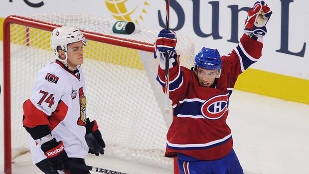 Gabriel Dumont, right, celebrates a goal against the Ottawa Senators by then-teammate Michael Cammalleri in Montreal on Saturday, Sept., 24, 2011. Dumont was recalled by the Montreal Canadiens from the Hamilton Bulldogs on Friday.