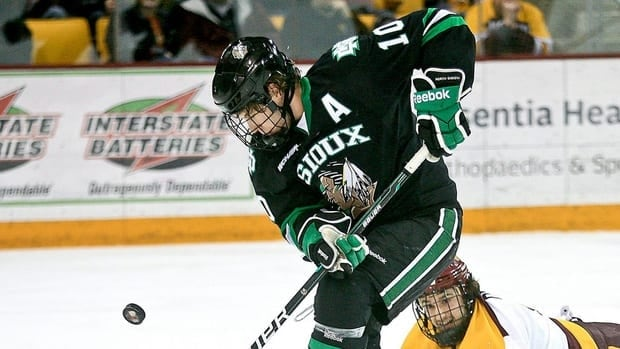 North Dakota's Corban Knight takes control of the puck during a college hockey game on Friday, Feb. 10, 2012, in Duluth, Minn.