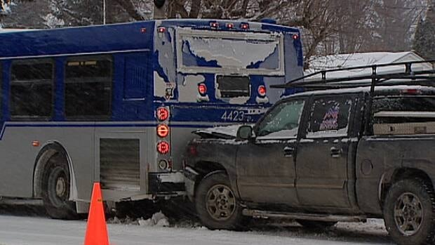 A truck rear-ends a city bus Thursday morning near 83rd Street and 80th Avenue in one of more than 200 collisions recorded in Edmonton over a 24-hour period.