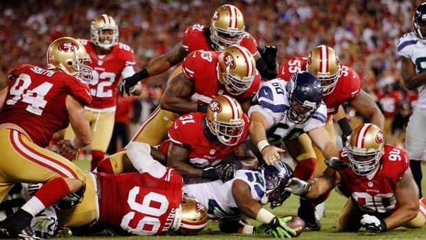 Marshawn Lynch of the Seattle Seahawks dives to regain controll of the ball against the San Francisco 49ers on October 18, 2012 at Candlestick Park in San Francisco.