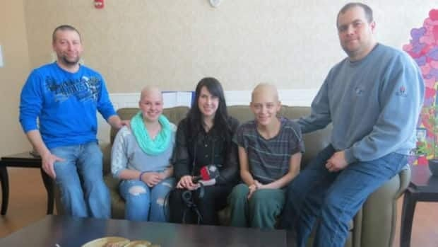 From left, Mike Ash, Kayla Ash, CBC's Caroline Hillier, Christina Dingwall, and Karl Dingwall. The two teenagers are both from Happy Valley-Goose Bay and have been diagnosed with the same form of cancer.