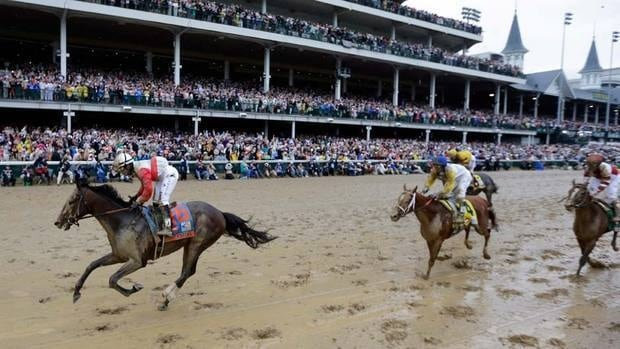 Joel Rosario rides Orb to victory in front of Canadian-owned Golden Soul, a rank outsider, in the 139th Kentucky Derby at Churchill Downs on Saturday. The muddy track didn't stop the co-favourite from taking top spot.