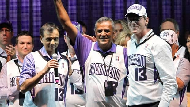 Vivek Ranadive, the new majority owner of the Sacramento Kings, left, introduces Kings investors Raj Bhathal, center and Paul Jacobs, to the crowd during a Kings rally last week.