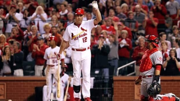 Lance Berkman, seen here with the St. Louis Cardinals, is close to a deal with the Texas Rangers according to a source familiar with the situation.
