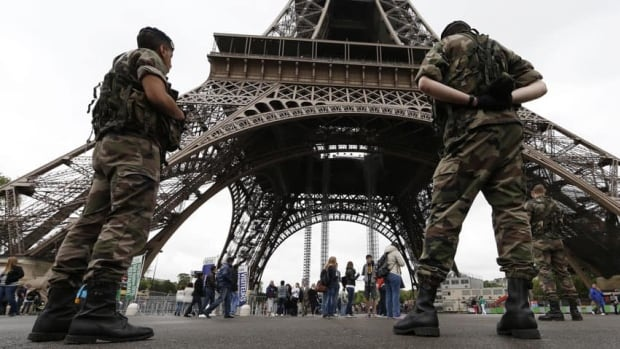 Soldiers on patrol near the Eiffel Tower in Paris in early May. A soldier was slashed in the throat on Saturday by an assailant who came from behind as he was on group patrol just outside Paris.
