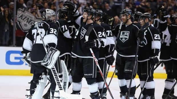 Goaltender Jonathan Quick (32) and the Los Angeles Kings celebrate their series-clinching 2-1 victory over the St. Louis Blues in Game 6 at Staples Center on Saturday in Los Angeles.