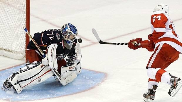 Columbus Blue Jackets goalie Sergei Bobrovsky stops a shot by Detroit forward Damien Brunner in the shootout on Sunday, the team's second straight win over the Wings.