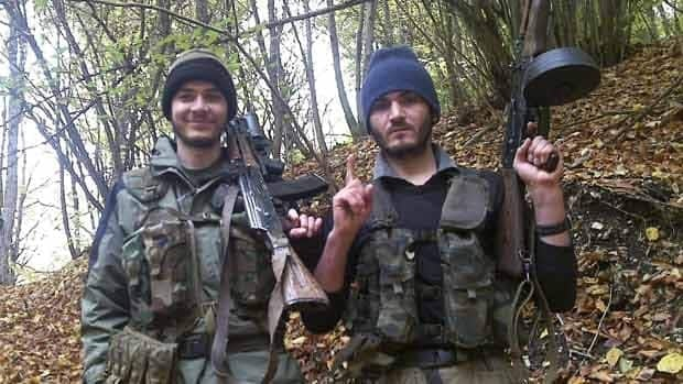This undated photo provided by the Dagestani branch of the Federal Security Service shows Canadian William Plotnikov, left, and an unidentified man. After Plotnikov was killed, Boston bombing suspect Tamerlan Tsarnaev left suddenly for the U.S.