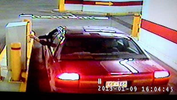 RCMP are searching for the victim's 1994 purple Saturn, as seen in this security video still.