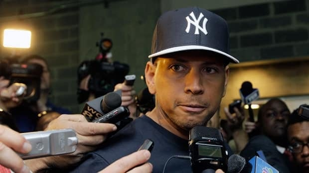 New York Yankees third baseman Alex Rodriguez, who is on the disabled list after hip surgery, talks to media outside the Yankees clubhouse before Opening Day against Boston on Monday.