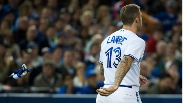Toronto Blue Jays third baseman Brett Lawrie throws his gloves off after being called out on strikes by home plate umpire Dan Bellino in the bottom of the third inning Friday.