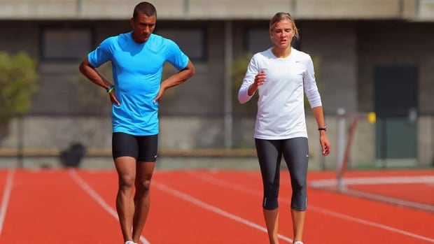 Ashton Eaton, right, of the USA Track and Field Team and Canadian Heptathlete Brianne Theisen, train at Hayward Field on the campus of the University of Oregon in April. The track and field power couple will marry on Saturday.