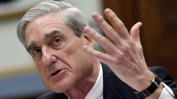 FBI Director Robert Mueller testifies before the U.S. House Judiciary Committee hearing on Federal Bureau of Investigation oversight Thursday. He said the government is doing everything it can to hold confessed leaker Edward Snowden accountable for splashing surveillance secrets across the pages of newspapers worldwide.