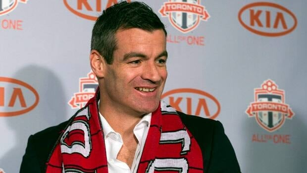 New Toronto FC head coach Ryan Nelsen smiles as he greets the media in Toronto on Tuesday.