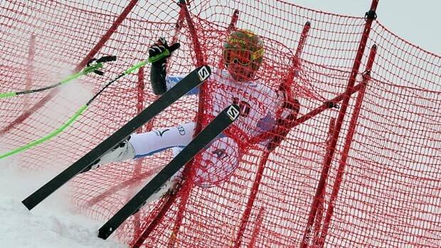 Austria's Klaus Kroell crashes during Thursday's race in Lenzerheide.