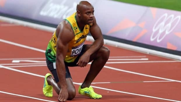 Italian police confiscated drugs in a raid on the hotel rooms of former world record holder Asafa Powell, above, Olympic medallist Sherone Simpson and trainer Chris Xuereb in Lignano Sabbiadoro on Monday.