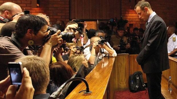 Olympic athlete Oscar Pistorius will defend himself against a charge of premeditated murder in the slaying of his girlfriend Reeva Steenkamp.