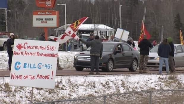 Demonstrators line Highway 102 in Nova Scotia to protest a federal bill they say undermines the treaty rights of aboriginals.