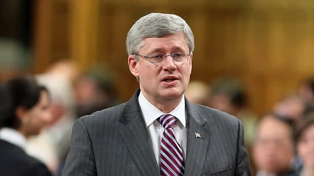 Prime Minister Stephen Harper stands in the House of Commons during question period on Thursday.