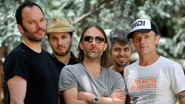 Nigel Godrich (left) and Thom Yorke (centre) said they're pulling music from their new Atoms For Peace collaboration off the streaming service Spotify over royalty payments they say are paltry. The group also includes Joey Waronker (second-left), Mauro Refosco (second-right) and Flea.