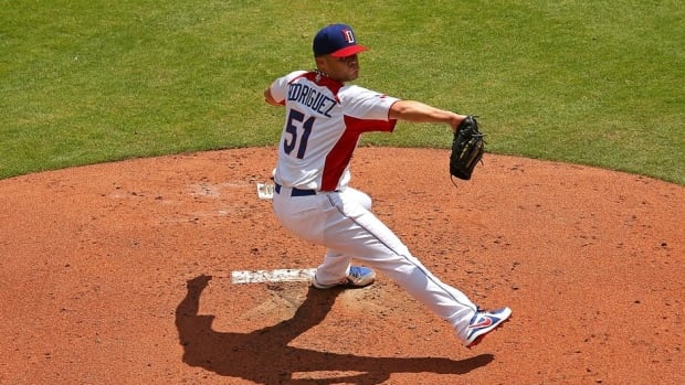 Wandy Rodriguez (51), of the Dominican Republic, pitched six innings during the second round game against Puerto Rico in Miami, Fla.