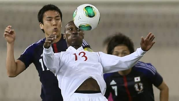 Japan's Makoto Hasebe challenges Canada's Atiba Hutchinson during their friendly in Doha on Friday.