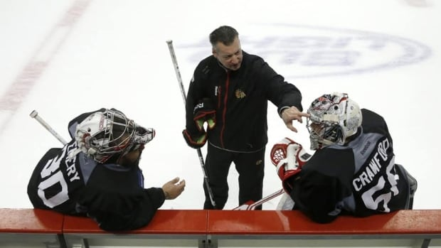 Chicago Blackhawks goalie coach Stephane Waite, centre, is shown coaching goalies Ray Emery, left, and Corey Crawford during practice before Game 5 of the Stanley Cup Final against the Boston Bruins.