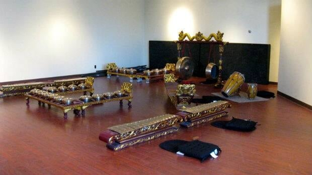 The gamelan is a custom-made Indonesian instrument, typically housed in carved teak frames.