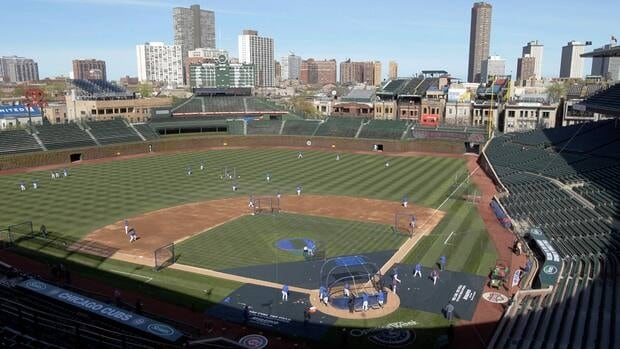 In this Apr. 4, 2012 file photo, Chicago Cubs players work out at Wrigley Field, the day before their opening game against the Washington Nationals.