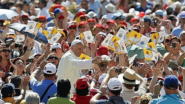 Pope Francis wades into a crowd of well-wishers during his weekly audience in Saint Peter's Square on Wednesday.