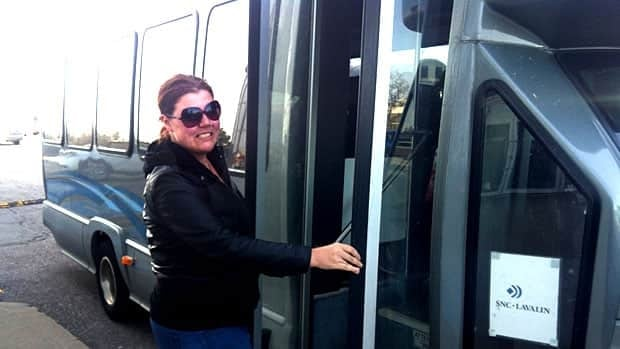 Danielle Cochrane boards a private shuttle bus to a business park in Mississauga.