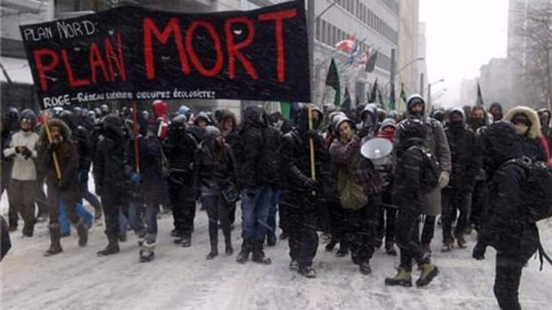 About two hundred people are demonstrating in the Montreal's financial district in protest of Quebec's Plan Nord.