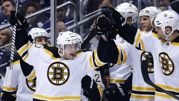 Boston Bruins forward Daniel Paille, centre, celebrates with teammatees after scoring on the Toronto Maple Leafs during the second period of Game 3 in Toronto on Monday.
