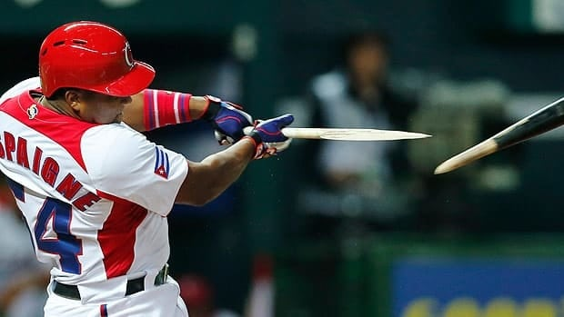 Cuba's Alfredo Despaigne broke his bat on this Masahiro Tanaka pitch in the fourth inning, but he later homered in the game at Fukuoka, Japan.