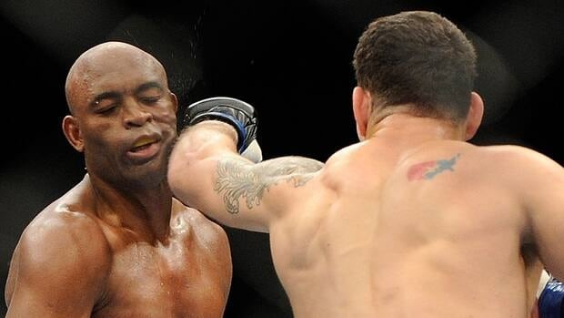 Chris Weidman connects with Anderson Silva during their UFC 162 middleweight championship on Saturday.