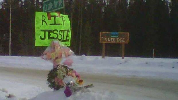 A roadside memorial lies beside the Alaska highway near Whitehorse where the accident that killed passenger Jessica Behan took place in February. The Yukon coroner says inexperienced driving may have contributed to the accident.