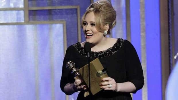 Adele accepts the Golden Globe Award for best original song for Skyfall on Jan. 13. She'll sing the James Bond theme at the Oscars gala in February.