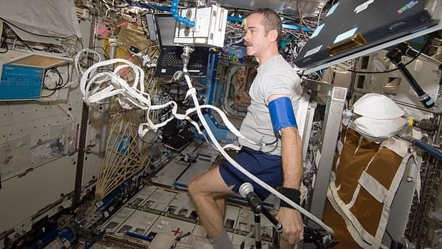 Chris Hadfield performs a fitness evaluation in the Destiny laboratory of the International Space Station on Dec. 21, 2012.