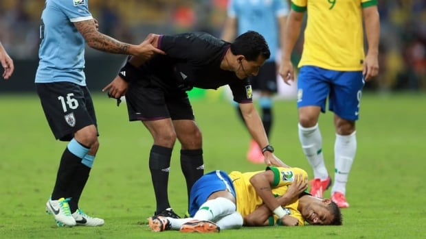 Referee Enrique Osses and Neymar of Brazil during the match between Brazil and Uruguay at Estadio Mineirao on June 26, 2013 in Belo Horizonte, Brazil.