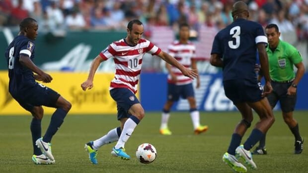 Belize defenders try to stop Landon Donovan (10) in Tuesday's's 6-1 Gold Cup loss to the U.S.
