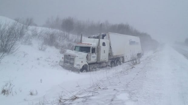 The icy roads are making driving difficult, as this truck driver discovered.