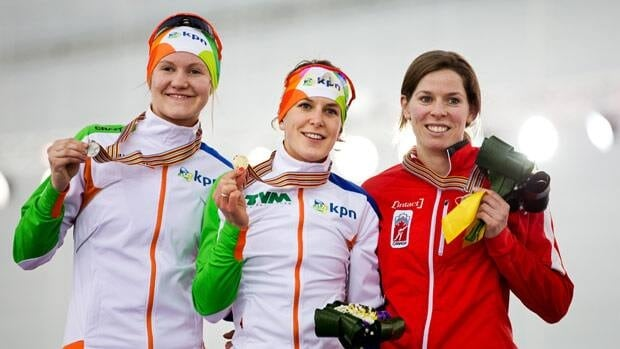 Christine Nesbitt, right, appears on the podium with Ireen Wust, centre, and Lotte van Beek, both from the Netherlands.