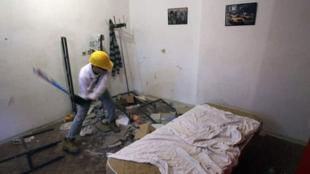 Savo Duvnjak smashes furniture and other household items during a demolishing session at the Rage Room in Novi Sad, Serbia.
