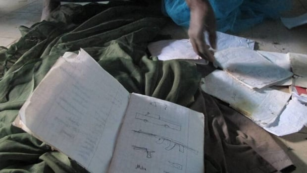 Timbuktu resident Mohamed Alassane sifts through documents left behind at the Ministry of Finance's Regional Audit Department, where a confidential letter from Abdelmalek Droukdel was found.