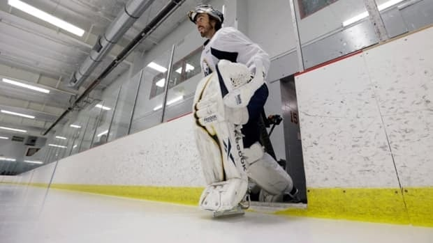 Buffalo Sabres goalie Ryan Miller skates onto the ice for an informal workout in Amherst, N.Y. on Friday.