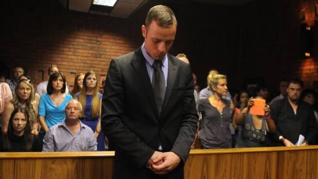 Henke Pistorius, second from left in the front row, attends a bail hearing for son Oscar in Pretoria, South Africa, on Feb. 21.