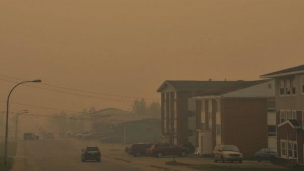 Smoke hung over the sky in western Labrador on Friday, including this street in Labrador City.