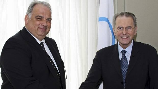 In this image made available by FILA News Bureau, IOC President Jacques Rogge, right, shakes hands Thursday with the acting head of wrestling's world governing body, Nenad Lalovic.