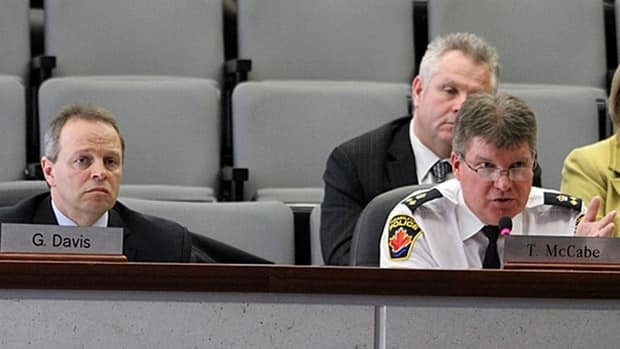 Deputy Chief Ken Leendertse from Hamilton Police Service, right, explains the budget to councillors as Ted Mason, the service's chief accountant, looks on. Hamilton's general issues committee voted down the police budget on Wednesday, which could ultimately lead to provincial arbitration.