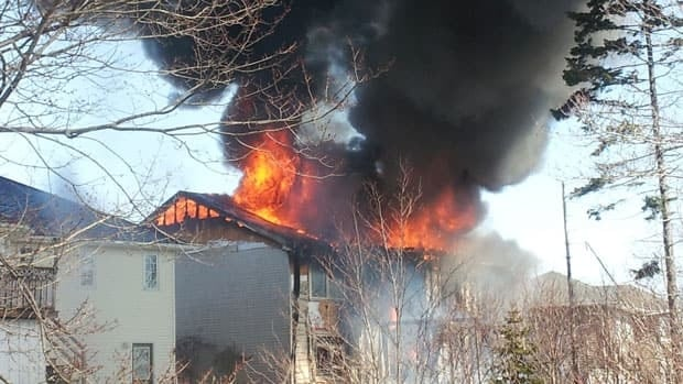 Neighbours watched as flames burned through the home.